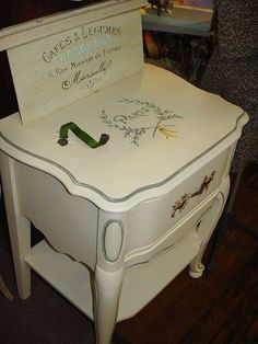 Like mellow yellow table? Vintage French Nightstand Paris Graphics Painted Furniture Grey Accents Chic. $145.00, via Etsy.