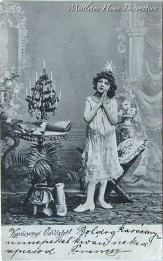 Vintage Hungarian Christmas postcard from 1904 with a girl praying in the drawing room - Black and white photo