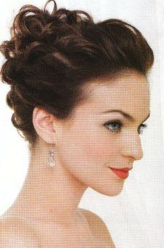 Very pretty. Curly hair, then twist hair back and pin at back of head. Then twist the ends and pin into a messy curly bun. Lovely :)
