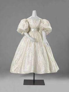 """1835 wedding dress from the Rijks Museum, the Netherlands. The description roughly translates as """"wedding gown of white silk gauze with a woven white satin flower and fringe pattern, with two intertwining flowers and vines."""" One of my favourites."""