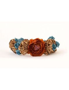 Rusty red and dusty gold with a light touch of sky blue makes a beautiful Fall color themed flower crown