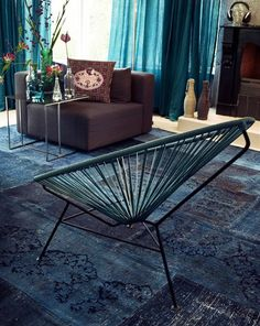 Color & Interior Decoration Trend 2012 - Blue & Concrete  the Industrial Look for the Home - Living Room with a Bleeched Blue Rug and Concrete Wallpaper of Concrete Wall!