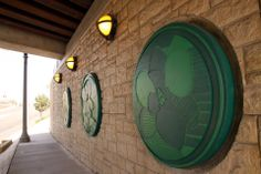 The Riverside Metropolitan Museum recently installed new art pieces on the Magnolia Avenue Underpass. The medallions were designed by a local artist Cosme Cordova and depict the Magnolia flower which is abundant throughout the City.