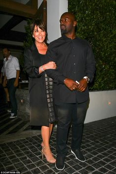 Cat that got the cream: Kris Jenner couldn't stop smiling as she left Cecconi's in West Hollywood with her boyfriend Corey Gamble
