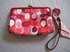 Authentic Coach Wristlet with pink patent leather accents - $75