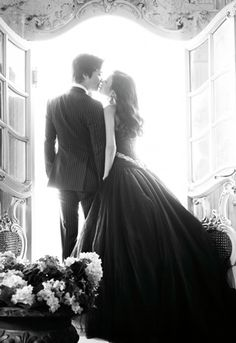 i love the silhouette of this dress and the waistline that drops in the back. i love the photo too; i'll need to find a beautiful window like this when the day comes.