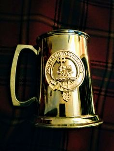 """Exquisite craftsmanship from Edwin Blyde & Co. Ltd., founded in Sheffield, England in the 18th century.  This fine Pewter Tankard has the Clan MacDonald Crest emblazoned on the front - it comes with a pamphlet with the history of the company - it is approx. 4.5"""" high - polish with a soft lint free non-abrasive cloth."""