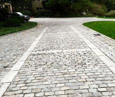 Full sized and square European cobbles make this driveway a standout.