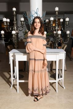 July 14 - Lily Collins attends AMBI Media Group Dinner at Hotel Mezza Torre More