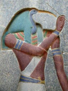 Thoth, the Egyptian God of wisdom, inventor of writing and patron of scribes, is represented here in composite form, human body and head of ibis - Temple of Amun in Luxor, Egypt.