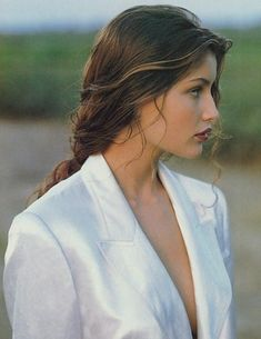 "Laetitia Casta (born: May Pont-Audemer, France) is a French actress and Super Model. Casta became a ""GUESS Girl"" in 1993 and gained further recognition as a Victoria's Secret Angel from 1998 to 2000 and as a spokesperson for cosmetics company L'Oreal. Laetitia Casta, Hair Inspo, Hair Inspiration, Pretty People, Beautiful People, French Actress, Belle Photo, Pretty Face, Curly Hair Styles"