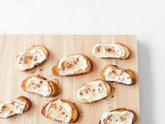 Get Giada De Laurentiis's Crostini with Ricotta and Pink Peppercorns Recipe from Food Network