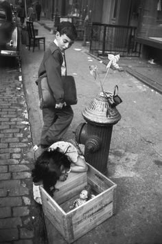 Schoolboy and girl with doll  Lower East Side New York 1957 Photo: Bruce Davidson