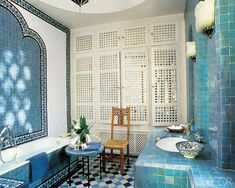 Moroccan Mood    At Dar Es Saada, the guesthouse at legendary couturier Yves Saint Laurent's Marrakech home, designer Bill Willis gave each of the six bathrooms its own style by employing tilework in an array of hues.