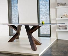 i love unconventional table legs with clean angular lines.