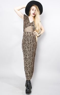 """Vintage 90sAmazing modern design in stretch knitLeopard print with mesh cutout sectionFabric hangs and clings beautifullyMaxi length and cap sleevesChest: 16"""" - 20"""" x2 Waist: 12-"""" 16"""" x2 Hips: 17"""" - 23"""" x2 Shoulder:n/aSleeve: 6"""" Length: 49"""" Estimated Size: Small Tag Size: n/a Condition: Good"""