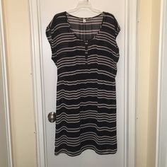 Striped dress. Lightly worn. Sheer outer layer and opaque black layer beneath. Cinches at waist. There is one small pull in the outer layer as seen in the third picture, but it's really not noticeable. Old Navy Dresses