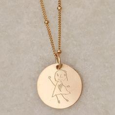 Wear your child's masterpiece close to your heart with the ESD Work of Art Necklace. This charm is engraved with your child's artwork on the front, and their name on the back.