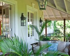 Easy living on this veranda decorated with lanterns and potted palms.