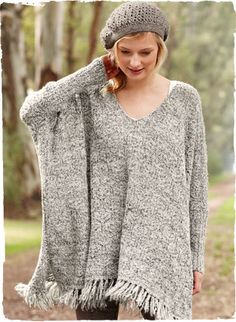 A portrait of laid-back chic, our lofty sleeved poncho is knit in tweeded bouclé yarns of baby alpaca (68%), wool (17%), nylon (8%) and silk...