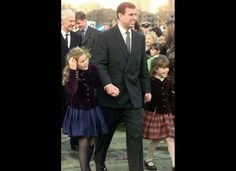 Prince Andrew, with Princesses Beatrice and Eugenie at the Greenwich Naval College for a Golden Wedding anniversary dinner celebration. 1997