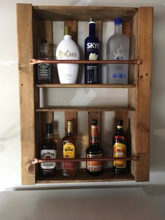 Liquor rack made from used pallets and copper piping.