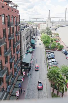 A view of River Street from the balcony at the Hyatt. See more on Savannah Soiree. http://www.savannahsoiree.com/journal/real-wedding-in-historic-downtown-savannah