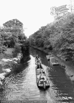 Daventry, The Canal c.1965. A motorised narrow boat tows its butty along behind – on the open canal, the 'snubber' or towing rope was normally 60 feet long. They are heading south on the Grand Union Canal from Braunston Tunnel.