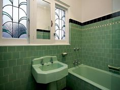 This might be nice with white tiles and a green/black border Art deco bathroom....love the shape of the sink