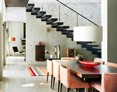 I love the table, adore the stairs, falling for those stairs(get it ;) ) but am absoluteley enamored with the concrete wall!