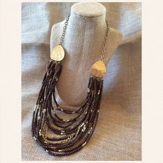 BOHO Wood Bead Necklace BOHO Style Wood Bead & Gold Necklace. Light Tarnish at Clasp (See Photo) hence the price. Perfect for so many BOHO looks!                                                                            ➖PRICE FIRM UNLESS BUNDLED➖ Charming Charlie Jewelry Necklaces