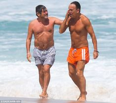 Still going strong: Bruce appears to be in top shape as he walked around the beach with a pal