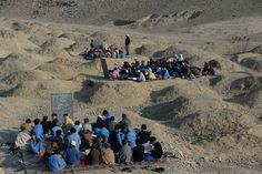 Mohmand Dara district, Afghanistan Schoolchildren study in open-air classrooms. The country's education system has been undermined by the Soviet invasion of a civil war in the and years of Taliban rule Schools Around The World, Around The Worlds, War Photography, Amazing Photography, Water Scarcity, Mosque Architecture, Save Our Earth, Indian Village, Picture Editor