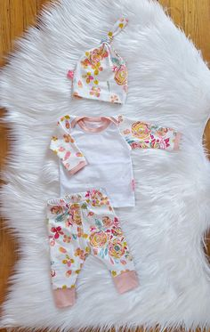 The sweetest baby girl outfit, perfect for spring!  This set is made from a super soft cotton knit jersey and includes the most gorgeous floral