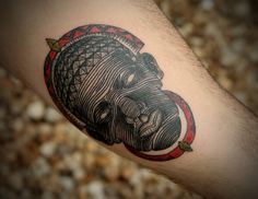 African Mask Tattoo On Arm