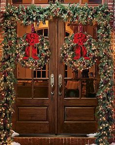 It's so much easier at Christmas to dress up a threshold!  I love these French doors and the way the garland and wreaths are backlit by the warm glow from inside.  Thanks to Angie Duysen for helping me to discover it. -- Eve.