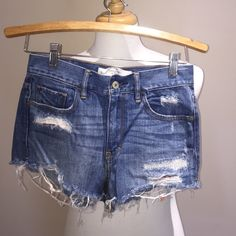 Abercrombie Destroyed High Waisted Denim Shorts Barley worn Abercrombie and Fitch lightly destroyed denim shorts. Shorts are high waisted with a slightly cheeky cut. include red flannel peekaboo design under the destroyed section. Size women 25 or size 0. Abercrombie & Fitch Shorts Jean Shorts