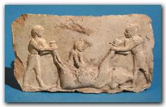 Babylonian Terracotta Plaque, c. 1900- 1750 B.C. (Babylonian Plaque) I Item categories: Near East  Depicting two men slaughtering a bull.