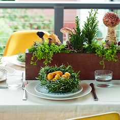 In a season that's often predictable, mix it up with a rosemary-nest place setting and a centerpiece of forest finds (take care with wild mushrooms; many are poisonous).     Tip: Rosemary stalks should be long and tender enough to curve into a bowl shape. Add kumquats for a splash of color.