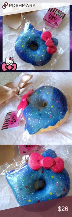 """Licensed JUMBO HELLO KITTY GALAXY DONUT SQUISHY ?? ????Soft and squishy!! Authentic licensed Hello Kitty donut squishy!   Jumbo sized! 5""""x4.5""""   Brand new, never opened or squished! Comes with tags, ball chain and dust plug. No visible defects.   SUPER KAWAII San rio  Accessories"""
