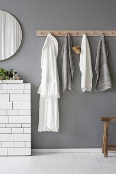 Love grey walls in the bathroom! They look so elegant. Add some wooden elements to create a warm atmosphere.