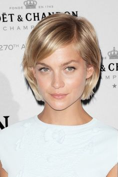 Haha! I chopped my hair off to something like this...well not as straight. See Mom, I am not the only one. lol ;)
