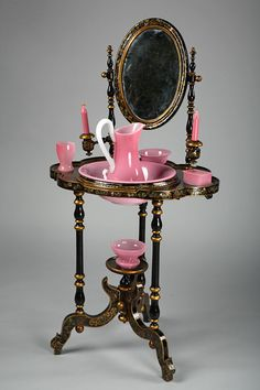A wood and papier mache black lacquered dressing table with an oval mirror,all inlaid with mother of pearl, and hand-painted with flowers and gilded patterns. Come with its...