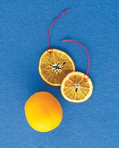 Citrus Slice Ornaments  Cut four unpeeled oranges into rounds about 1/4-inch thick and bake on a greased cookie sheet at 175 degrees for 4 hours. To hang, poke a hole near one edge with a needle and thread doubled twine through to make a loop.
