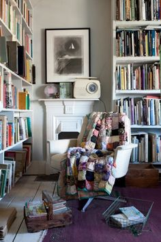 This great reading chair coms complete with a stack of mags and a quilt! *Snug*