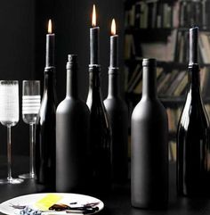 black painted bottles for candle holders