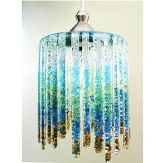 """This lamp is made with System 96 sheet glass and frit. The frit is actually tack fused to the inside of the lamp rather than the outside. It is approximately 9"""" in diameter and is an original design."""
