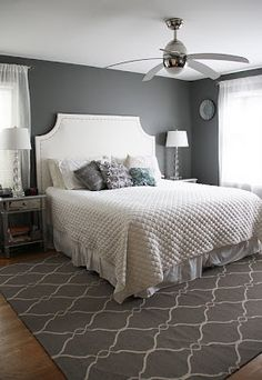 Grey walls, white furniture, charcoal rug bedroom