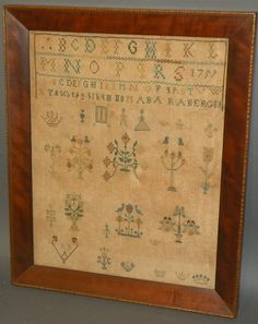 Pennsylvania German cross stitched sampler