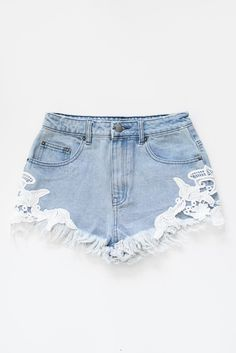 Vintage inspired high waist light blue denim shorts with crochet detailing on sides. Classic zipper fly with two front pockets and two back pockets. Made with n